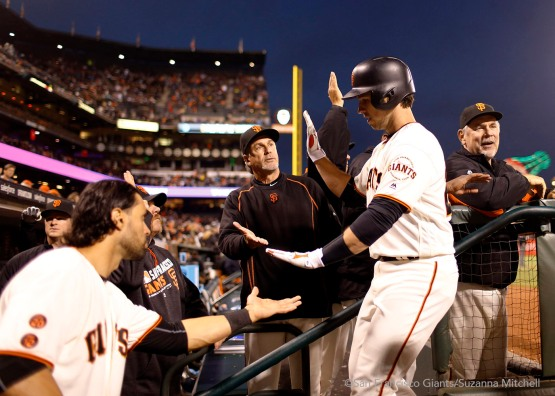 Buster Posey celebrates after hitting a home run in the sixth inning.