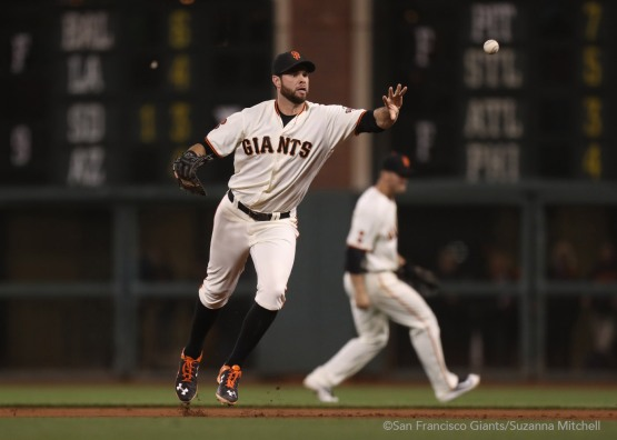 Brandon Belt throws out Carlos Gonzalez to end the game.