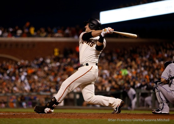 Buster Posey hits a home run in the sixth inning.