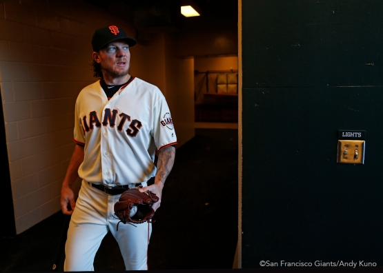 San Francisco Giants pitcher Jake Peavy walks to the dugout before the game.