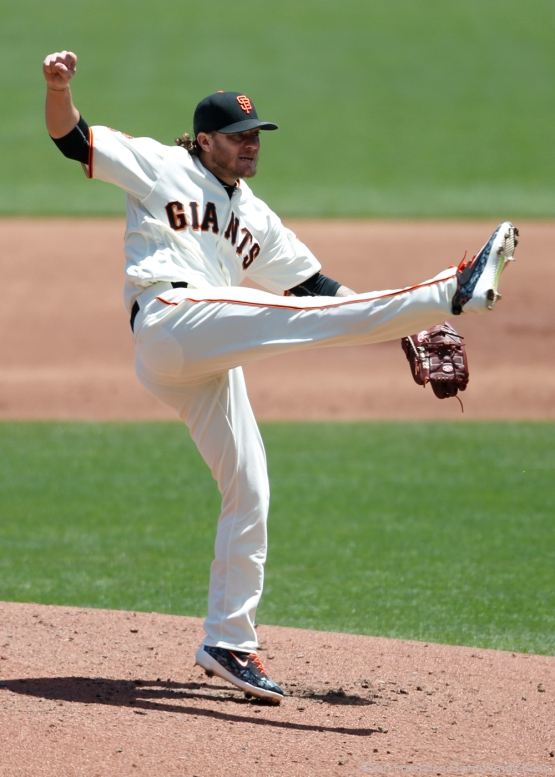 San Francisco Giants pitcher Jake Peavy follows through on his pitch during the 2nd inning.