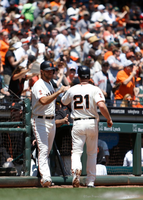 Madison Bumgarner high fives Conor Gillaspie after he homered in the third inning.