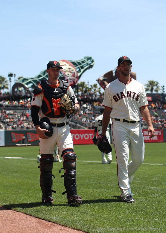 Trevor Brown and Madison Bumgarner walk to the dugout after warming up before the game.