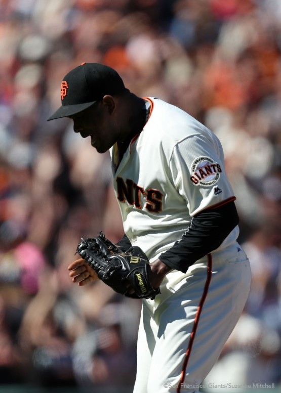 Santiago Casilla celebrates after striking out Daniel Murphy to end the game.