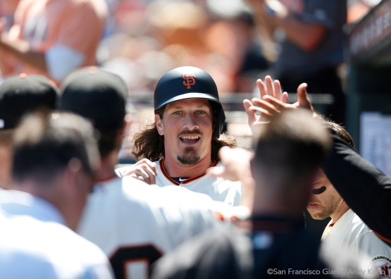 Jeff Samardzija celebrates after scoring as a pinch runner for Madison Bumgarner and scoring on an error hit into by Hunter Pence in the fifth inning.
