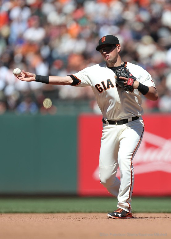 Joe Panik throws out Ben Revere in the fifth inning.