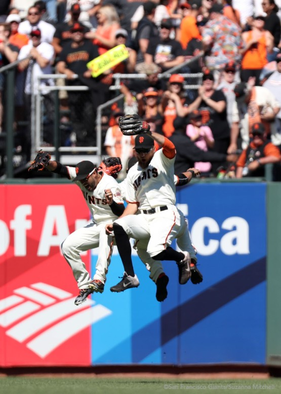 Gregor Blanco, Angel Pagan and Hunter Pence celebrate after the ninth inning.