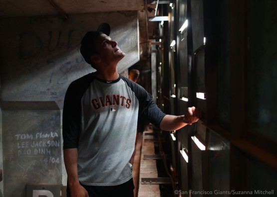 Javier Lopez searches for his signature from when he was on the Red Sox at Fenway Park.
