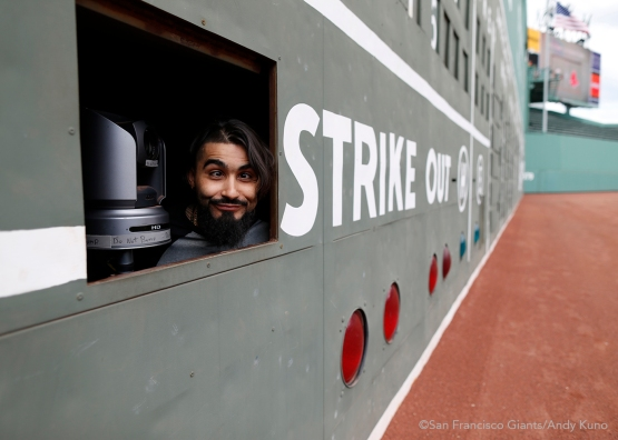 San Francisco Giants reliever Sergio Romo peeks outside the Green Monster.