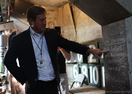 Bobby Evans finds his signature from the year 1989 behind the Green Monster at Fenway Park.