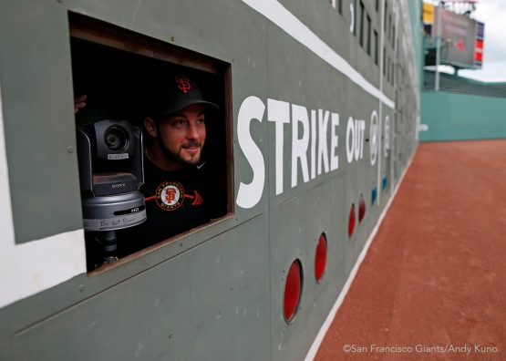 San Francisco Giants reliever George Kontos peeks outside the Green Monster.