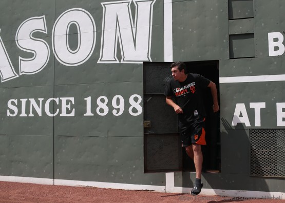 Derek Law exits after signing the wall behind the Green Monster at Fenway Park.