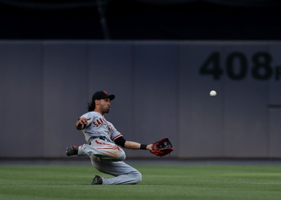 Angel Pagan catches a fly ball in left field hit by Starlin Castro and doubled off Brian McCann to end the eighth inning.