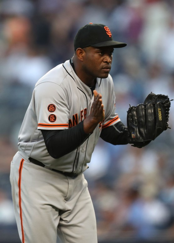 Santiago Casilla celebrates after getting out of the eleventh inning.