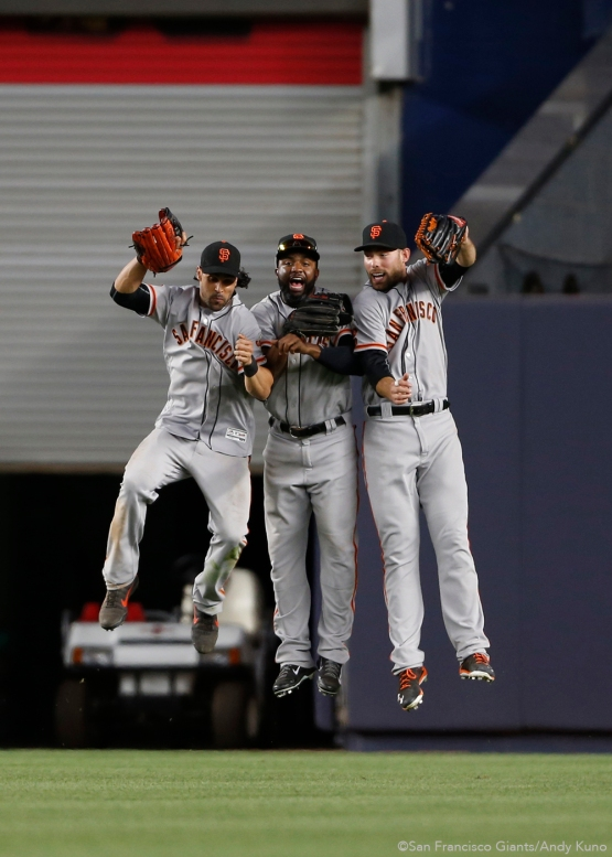 San Francisco Giants Angel Pagan, Denard Span and Mac Williamson celebrate their 12th inning win over the Yankees.