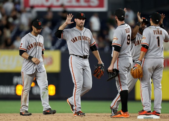 Angel Pagan, Mac Williamson, Brandon Belt, Denard Span and Ramiro Pena celebrate after beating the New York Yankees 2-1.