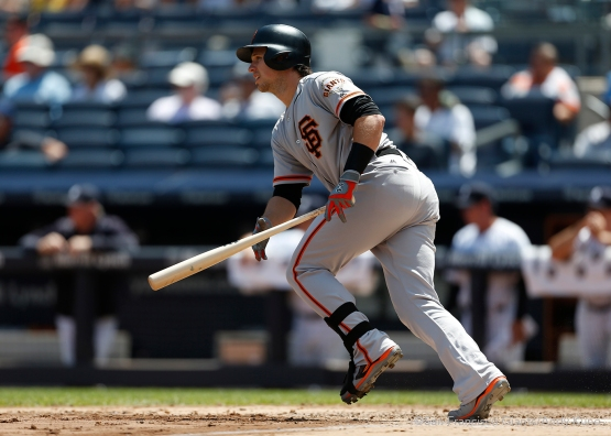 San Francisco Giants Buster Posey singles during the 4th inning at Yankee Stadium.