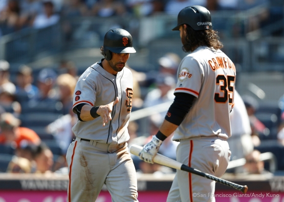 San Francisco Giants Angel Pagan celebrates with Brandon Crawford after his 6th inning run at Yankee Stadium.