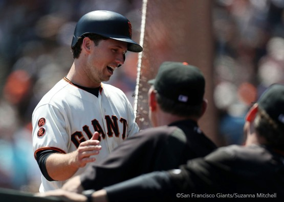 Buster Posey celebrates after scoring in the fourth inning.