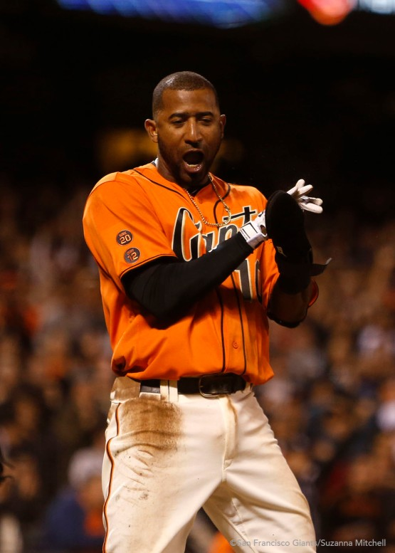 Eduardo Nunez celebrates after scoring in the seventh inning.