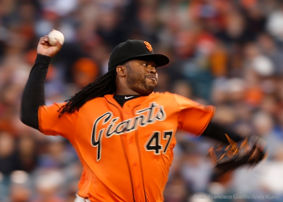 Johnny Cueto pitches during the first inning.