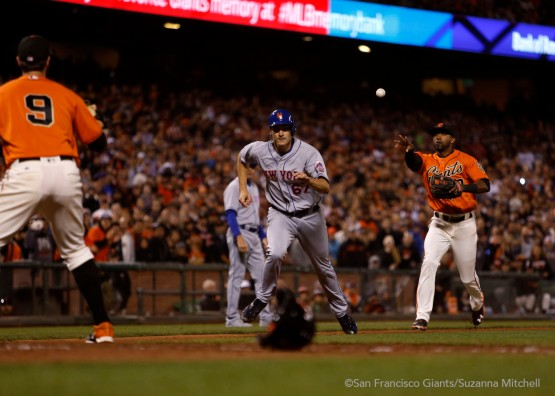 Brandon Belt and Eduardo Nunez hold Seth Lugo in a run down in the fifth inning.