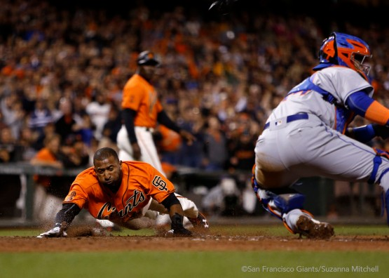 Eduardo Nunez slides safely home on a single hit by Ehire Adrianza in the seventh inning.