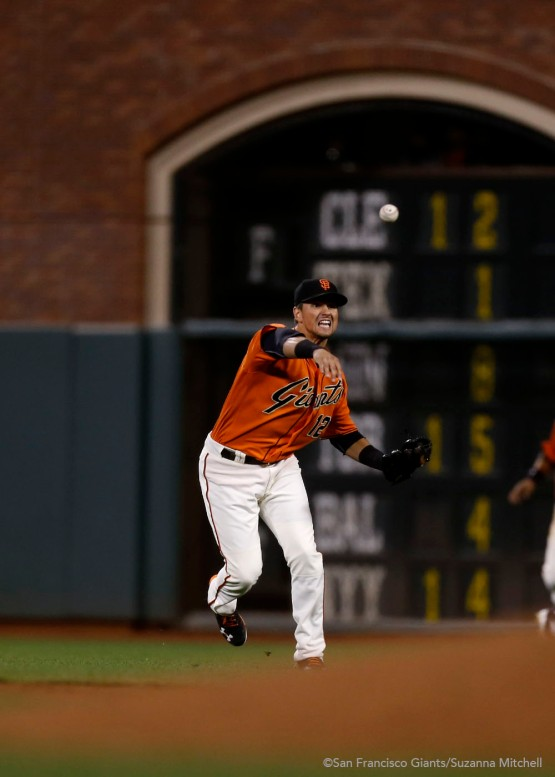 Joe Panik throws out Matt Kemp in the fifth inning.