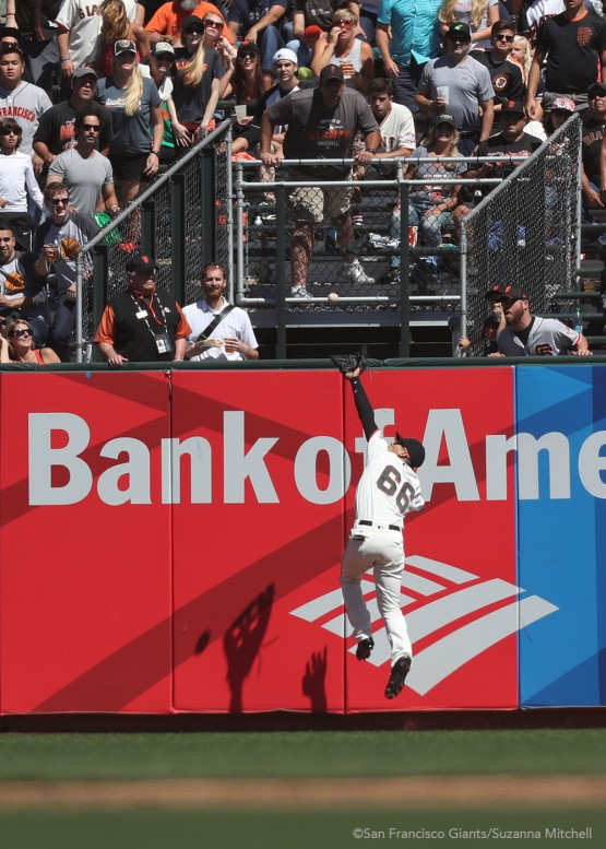 Gorkys Hernandez catches a fly ball in center field hit by Paul Goldschmidt in the sixth inning.