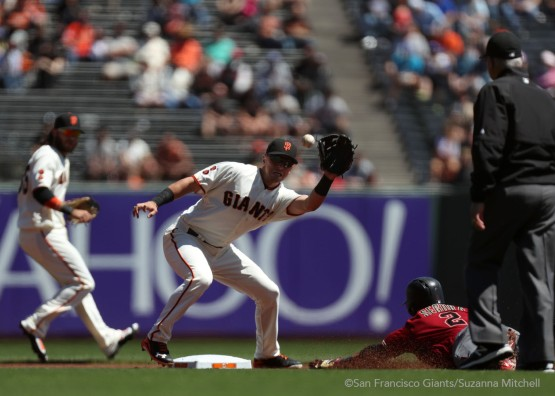 Joe Panik tags out Jean Segura on a fielder's choice in the first inning.