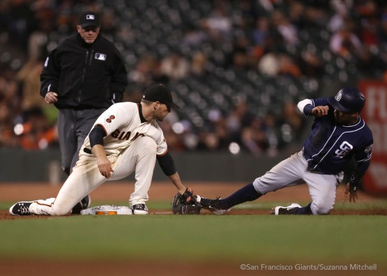 Conor Gillaspie tags out Alexei Amarista attempting to steal third base in the ninth inning.