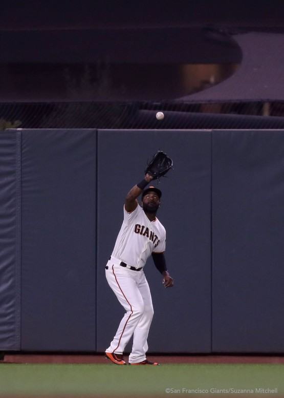 Denard Span catches a fly ball in center field hit by Ryan Schimpf in the eighth inning.