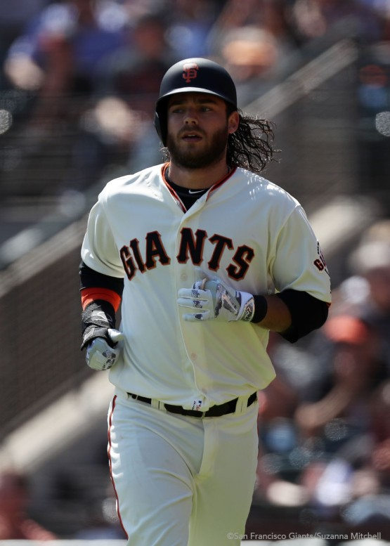 Brandon Crawford scores on a single hit by Joe Panik in the second inning.