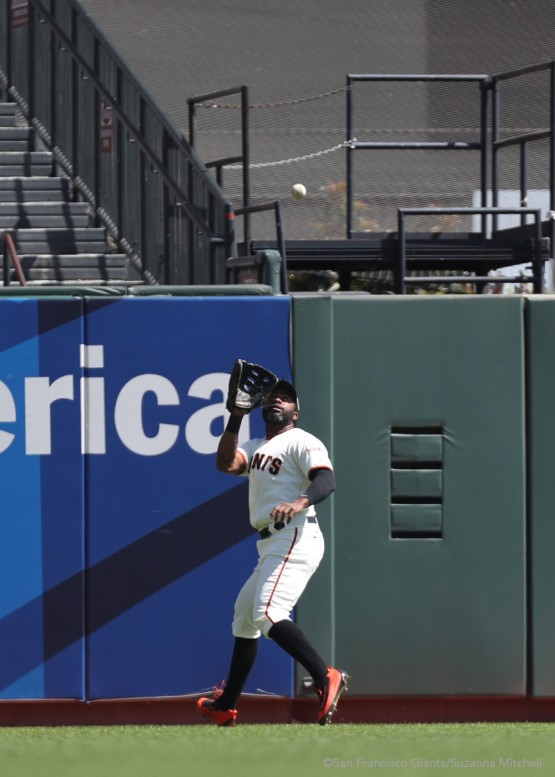 Denard Span catches a fly ball in center field hit by Alex Dickerson in the fourth inning.
