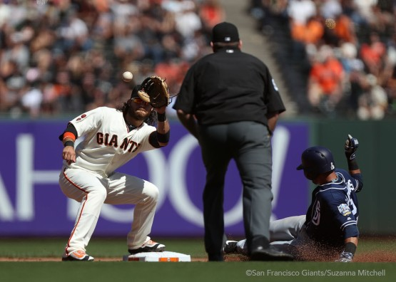 Brandon Crawford attempts to tag out Luis Sardines stealing second base.