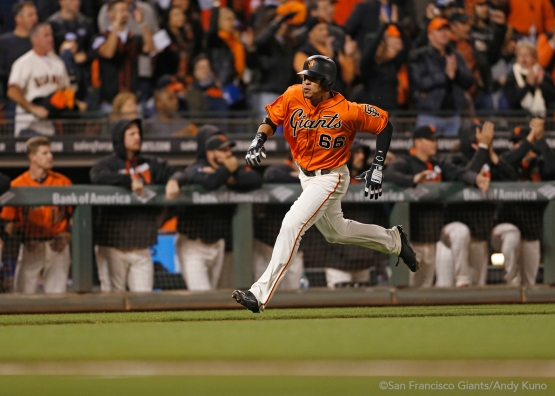 Gorkys Hernandez scores on a single hit by Buster Posey in the first inning.