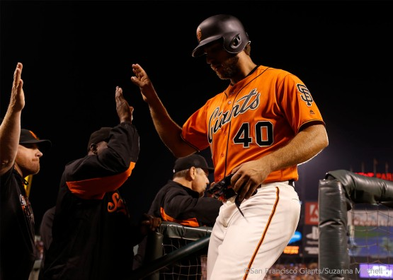 Madison Bumgarner celebrates after scoring on a home run hit by Brandon Belt in the sixth inning.