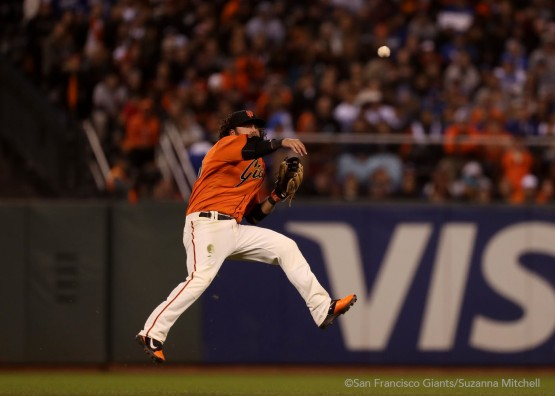 Brandon Crawford throws out Carlos Ruiz in the eighth inning.