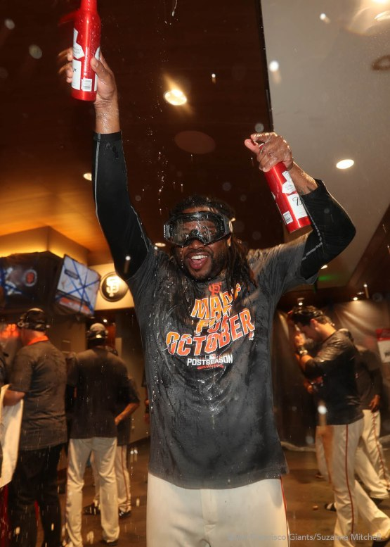 Johnny Cueto celebrates in the clubhouse.