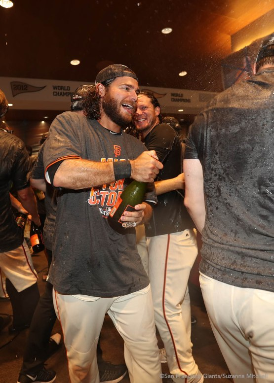Brandon Crawford celebrates in the clubhouse.