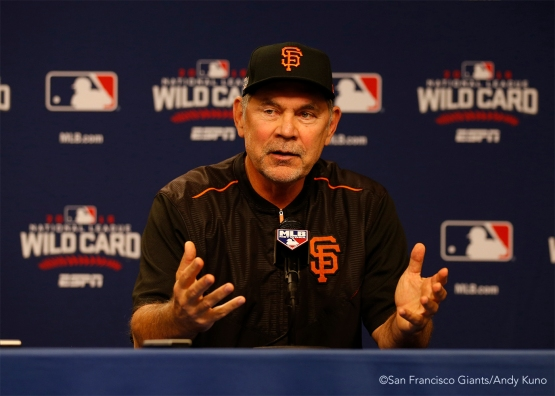 Bruce Bochy talks to the media during a press conference.