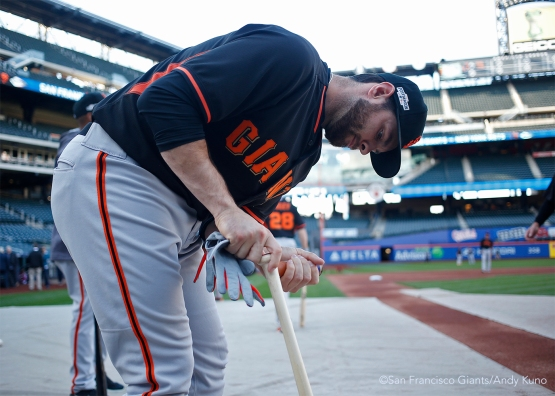 Brandon Belt prepares his bat during batting practice.