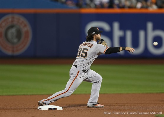 Brandon Crawford tags out Rene Rivera and throws out James Loney in the third inning.