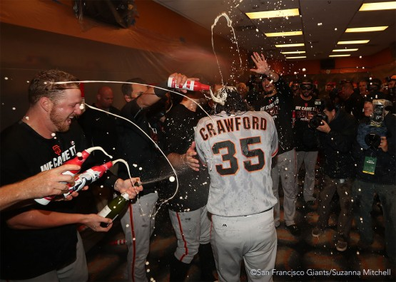 The team soaks Brandon Crawford in the clubhouse.