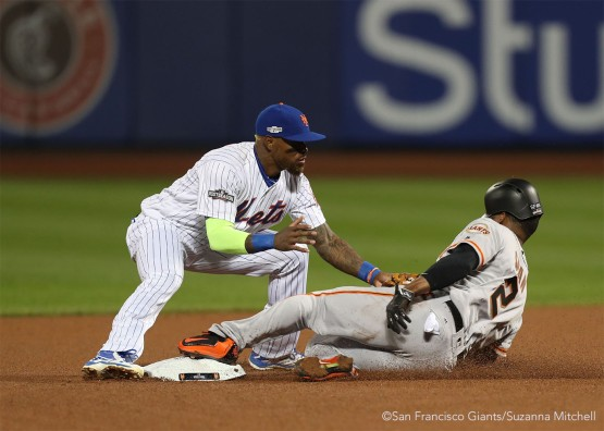 Jose Reyes tags out Denard Span attempting to steal second base in the fourth inning.