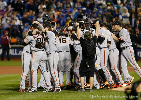 The team celebrates after the final out of the ninth inning.