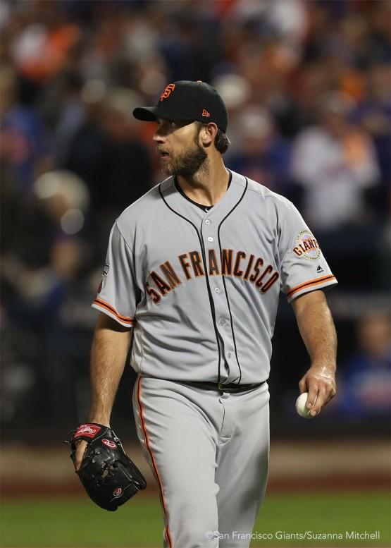 Madison Bumgarner leaves the field after catching a ball lined by Adsdrubal Cabrera to end the eighth inning.