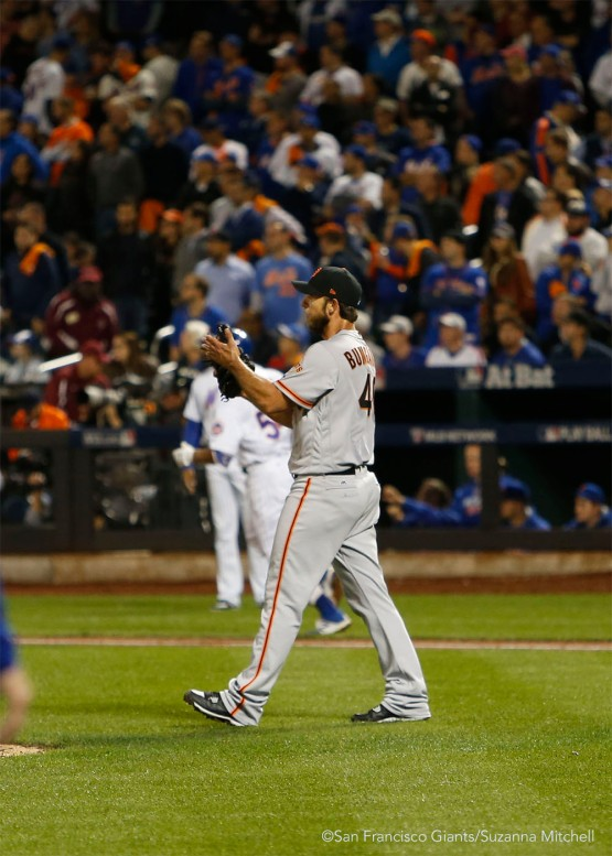 Madison Bumgarner celebrates after the final out of the ninth inning.