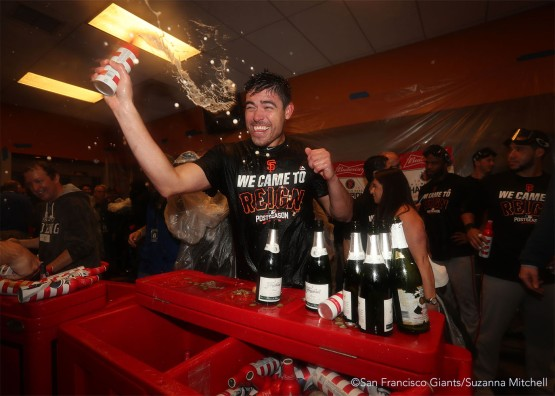 Matt Moore celebrates in the clubhouse.