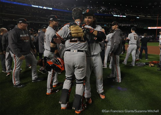 Buster Posey and Brandon Crawford celebrate after the end of the game.